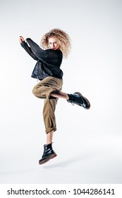 Young beautiful female dancer is posing in the studio