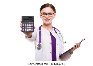 Young beautiful female doctor holding clipboard and showing calculator in her hands on white background