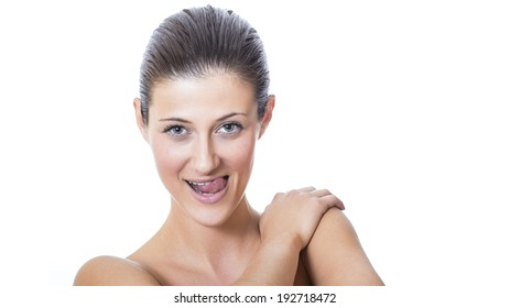 Young beautiful female face with healthy skin. Girl showing tongue and make expression face