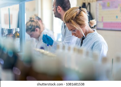 Young and beautiful female scientist working in laboratory doing some research