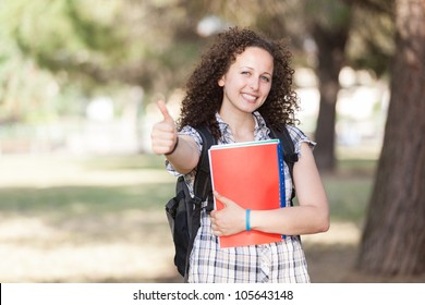 Young Beautiful Female Student with Thumb Up