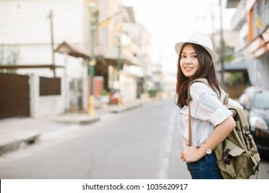 Young beautiful female traveler in the city