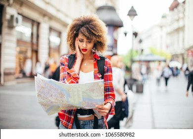 Young beautiful female traveler lost in the city