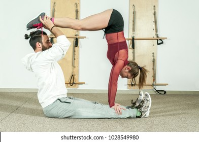 Young beautiful fitness couple workout extreme acrobatic exercise as preparation for the competition, selective focus
