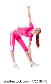 Young beautiful fitness woman in pink over white