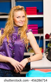 Young beautiful ginger woman in clothing store