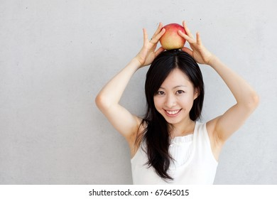 young beautiful girl with apple