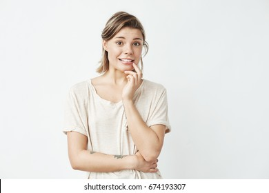 Young beautiful girl ashamed looking at camera  over white background.