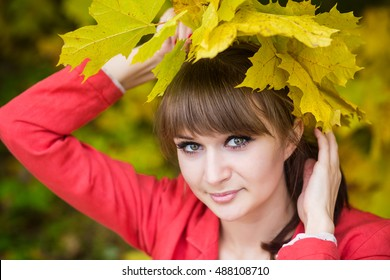 young beautiful girl in the autumn forest