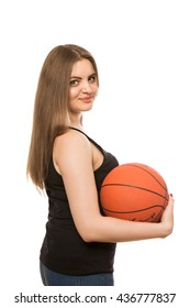 young beautiful girl with a basketball ball in hands isolated on white background