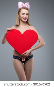 young and beautiful girl with a big red heart