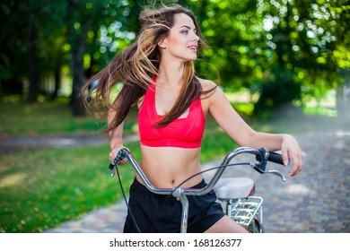 young beautiful girl with bike outdoor