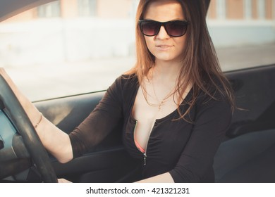 Young beautiful girl in black glasses with dark lipstick