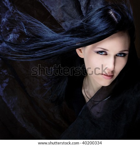 girl with black hair and blue eyes