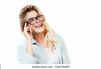 Young beautiful girl with broken glasses and lenses in the hands on a white isolated background. The concept of vision, health