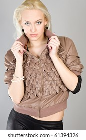 young beautiful girl in a brown blouse