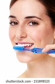 Young beautiful girl brushing teeth with toothbrush.