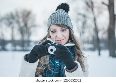 Young beautiful girl with a camera