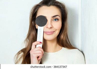 young beautiful girl checks eyesight ophthalmologist. Ophthalmologist. medical, health, ophthalmology concept