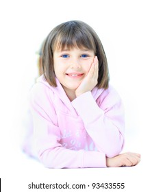 Young beautiful girl child smiles happy into camera. Isolated on white background.