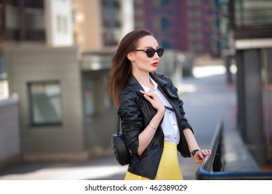 Young beautiful girl in the city in casual clothes