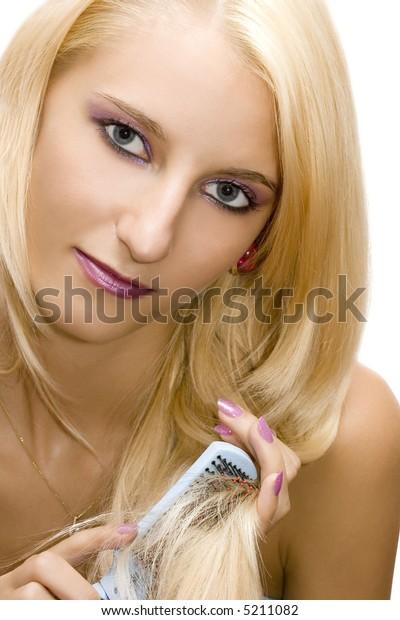 young beautiful girl combing her hairs