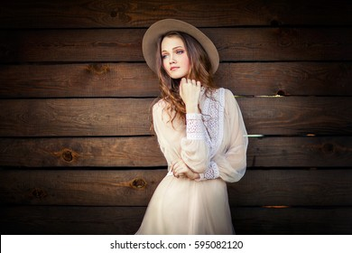 Young beautiful girl in a cowboy hat 20bb0429f27c