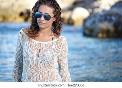 young beautiful girl in dress on the Croatia coast