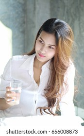 Young beautiful girl Drink Water