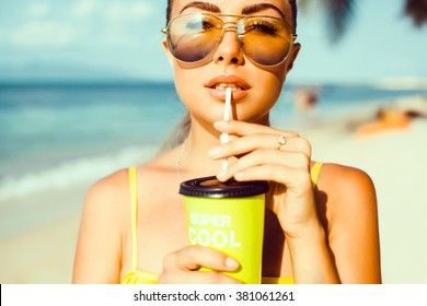 Young beautiful girl Drinking a Bottle of Green Juice with Straw   blue sky, holding a glass of smoothie, detox, healthy food, fruit cocktail outdoor portrait,close up,tasty,smiling enjoy her weekends