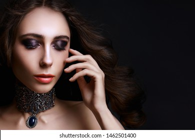 Young beautiful girl with fancy Halloween party hairdo and make-up, copy space