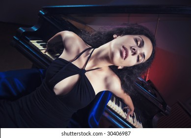 Young and beautiful girl feel the passion of  love with music of a grand piano in background
