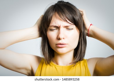 young beautiful girl feels headache isolated on white background