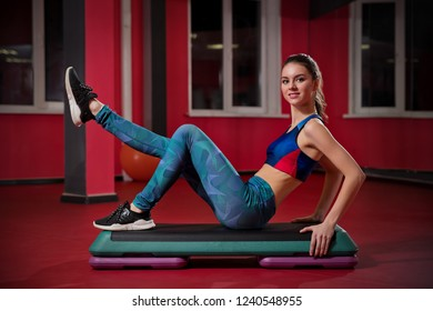 Young beautiful girl in fitness club