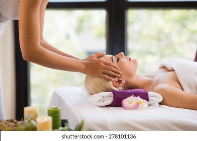 Young beautiful girl getting scalp massage in the salon