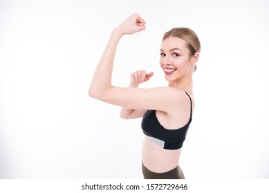 Young beautiful girl goes in for sports on white background