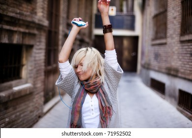 Young beautiful girl happy and dancing