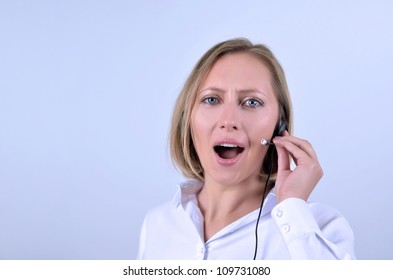Young beautiful girl with headphone in call center