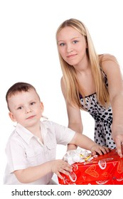 young beautiful girl and her little brother near the gifts