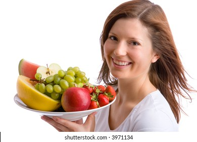 young, beautiful girl is holding a plate full of fruits