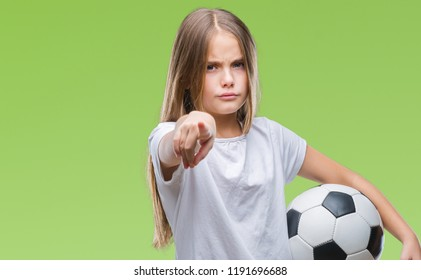 Young beautiful girl holding soccer football ball over isolated background pointing with finger to the camera and to you, hand sign, positive and confident gesture from the front