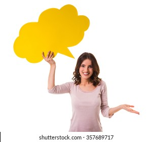 Young beautiful girl holding a yellow bubble for text, isolated on a white background