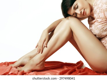 young and beautiful girl hugging her silky smooth legs