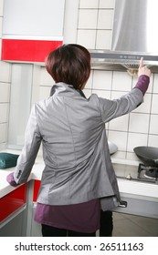 young beautiful girl in kitchen