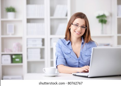 Young beautiful girl with a laptop at home
