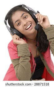 Young beautiful girl listening music in headphone over white background