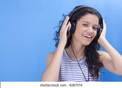 young beautiful girl listening music