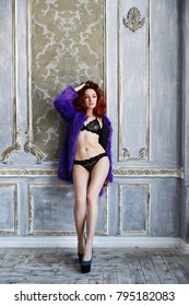 The young beautiful girl with long curly red hair in a violet fur coat and black underwear and poses, long legs, a sexual figure, Beautiful hips, flirting, a languishing look, ginger hair
