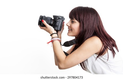 Young and beautiful girl is looking through the camera