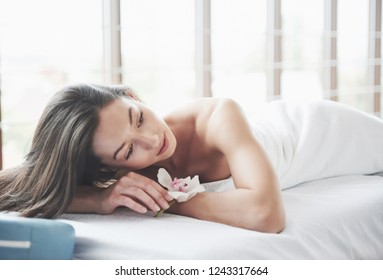 Young beautiful girl lying on a massage table